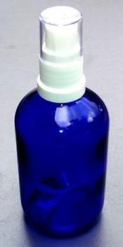 Blue glass spray bottle with atomizer